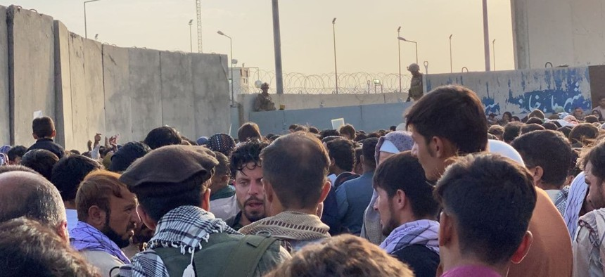 People who want to flee the country continue to wait around Hamid Karzai International Airport in Kabul, Afghanistan on August 24, 2021.