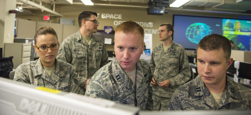 Airmen of the Joint Space Operations Center monitor computer systems designed to detect, track, and identify all artificial objects in Earth's orbit at Vandenberg Air Force Base, Calif., in 2014.