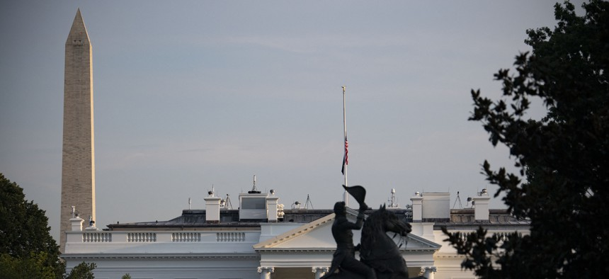 The U.S. flag flies at half mast over the White House after President Joe Biden delivered remarks on the terror attack at Hamid Karzai International Airport, and the U.S. troops and Afghan victims killed and wounded, August 26, 2021.