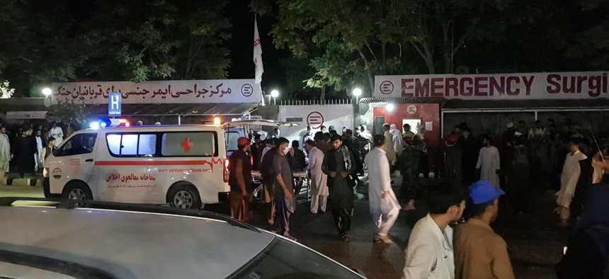 Injured people being carried to a hospital after explosions outside Hamid Karzai International Airport in Kabul, Afghanistan, on August 26, 2021.