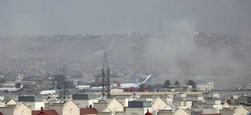 Smoke rises from a deadly explosion outside the airport in Kabul, Afghanistan, Thursday, Aug. 26, 2021.