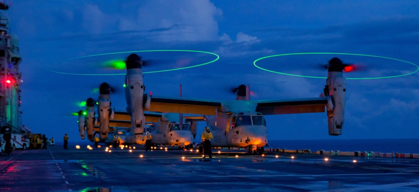 Marine Corps MV-22Bs with the 31st Marine Expeditionary Unit prepare for take-off from the amphibious assault ship USS America in the Philippine Sea, Aug. 17, 2021.