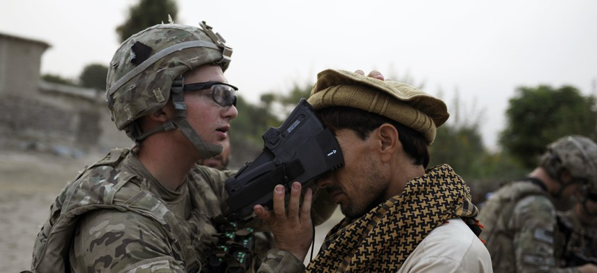 A U.S. Army soldier scans the irises of an Afghan civilian in 2012 as part of an effort by the military to collect biometric information from much of the Afghan population.