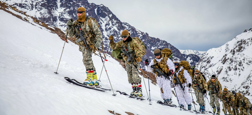 U.S. Army soldiers and Chilean army soldiers cross-country ski at the Chilean Army Mountain School in Portillo, Chile, Aug. 27, 2021.
