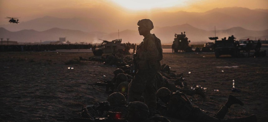 Soldiers assigned to the 10th Mountain Division stand security at Hamid Karzai International Airport, Kabul, Afghanistan, Aug.15, 2021.