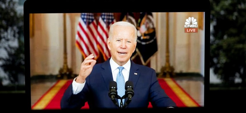 President Joe Biden is seen on screen as he delivers remarks at the White House in Washington D.C. Aug. 31, 2021.