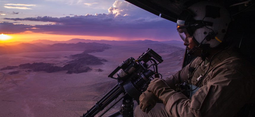U.S. Marine Corps Sgt. Reginald Smith rides in a Bell UH-1Y Venom helicopter during Fire Support Coordination Exercise at Marine Corps Air Ground Combat Center, Twentynine Palms, California, July 21, 2021.