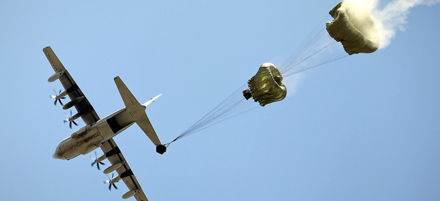 A C-130 transport aircraft air drops container delivery systems with water cargo, Sept. 9, 2011.