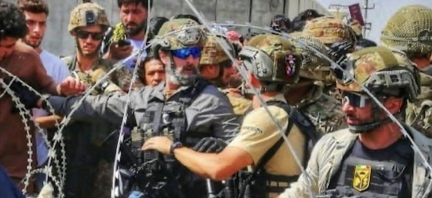 Carabinieri help with the evacuation at Kabul Airport.