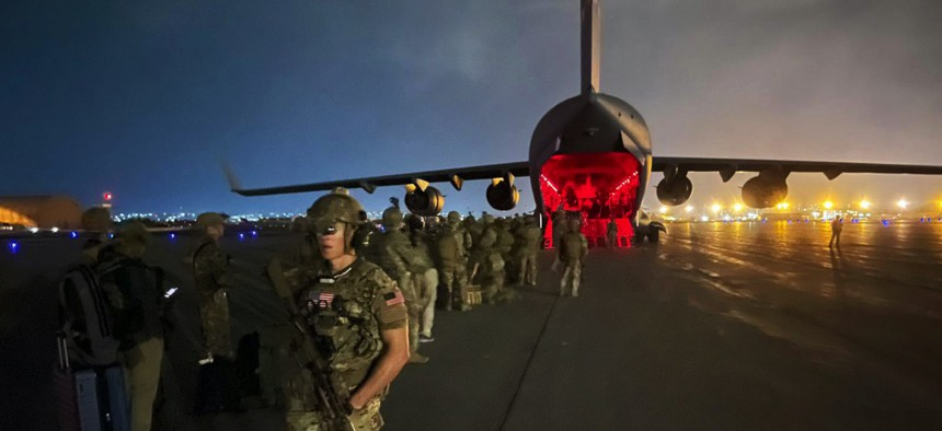 Army paratroopers assigned to the 82nd Airborne Division prepare to board an Air Force C-17 at Hamid Karzai International Airport in Kabul, Afghanistan, Aug. 30, 2021
