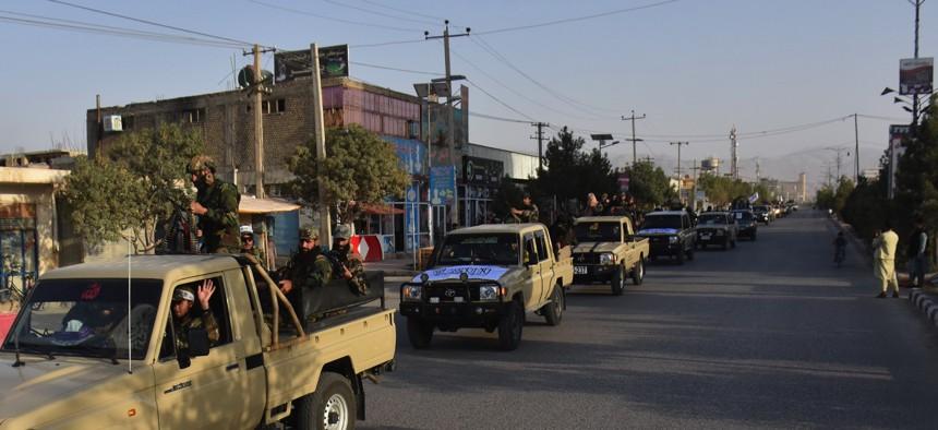 Military vehicles run in Mazar-i-Sharif, capital of northern Balkh province, Afghanistan, Aug. 31, 2021.