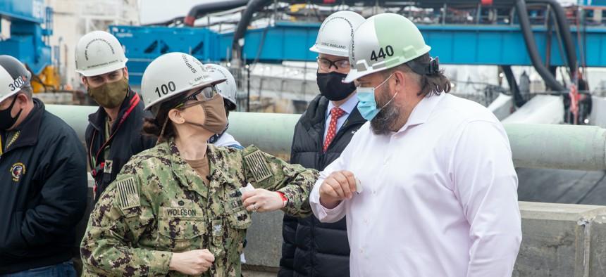 Shipbuilding specialist Chad Johnson receives an award at Norfolk Naval Shipyard, Virginia, in January 2021.