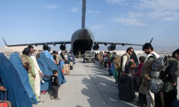 U.S. Air Force loadmasters and pilots load passengers aboard a U.S. Air Force C-17 Globemaster III in support of the Afghanistan evacuation at Hamid Karzai International Airport, Afghanistan, Aug. 24, 2021.