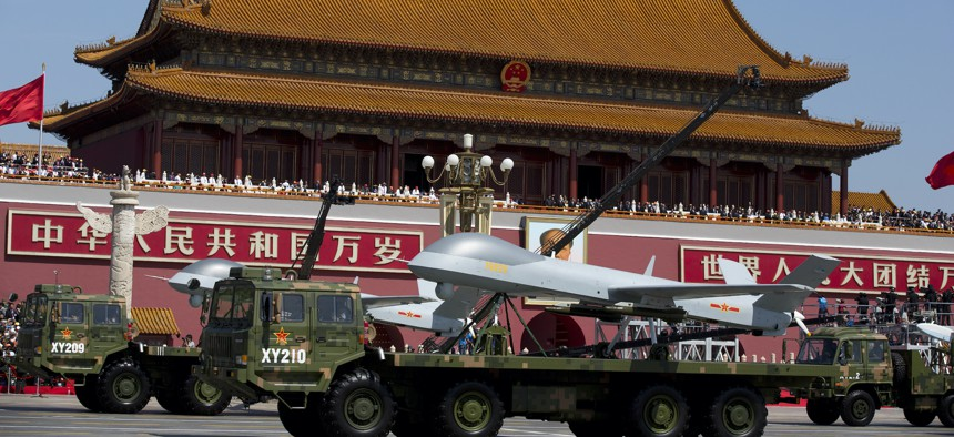 Military vehicles carrying Wing Loong, a Chinese made medium-altitude long-endurance unmanned aerial vehicle, drive past Tiananmen Gate in Beijing, Sept. 3, 2015.