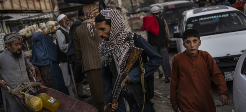 Taliban fighters patrol a market in Kabul's Old City, Afghanistan, Tuesday, Sept. 14, 2021.