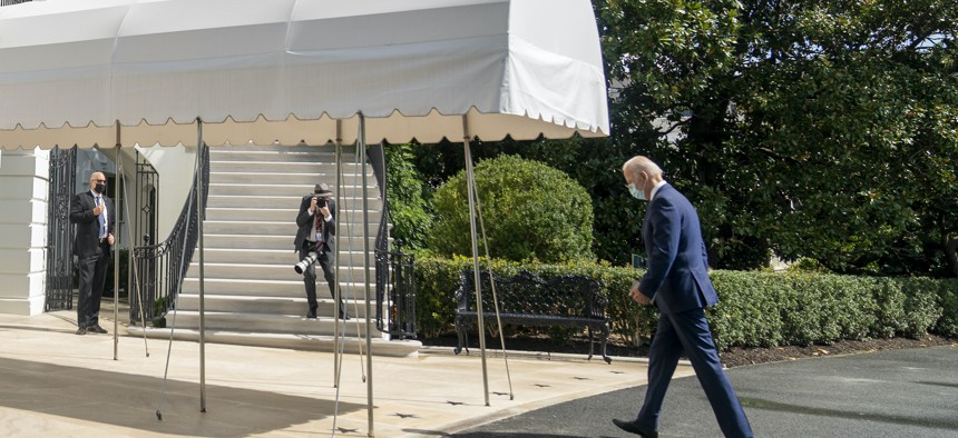 President Joe Biden arrives at the White House in Washington, Sept. 20, 2021, after returning from Rehoboth Beach, Del.