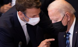 France's President Emmanuel Macron (L) talks to US President Joe Biden before a meeting of the North Atlantic Council at the North Atlantic Treaty Organization (NATO) headquarters in Brussels on June 14, 2021.