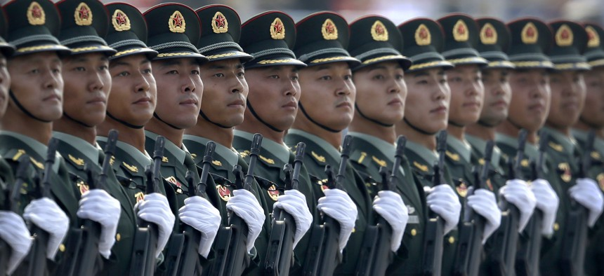 In this Oct. 1, 2019, photo, Chinese People's Liberation Army (PLA) soldiers march in formation during a parade to commemorate the 70th anniversary of the founding of the People's Republic of China in Beijing.