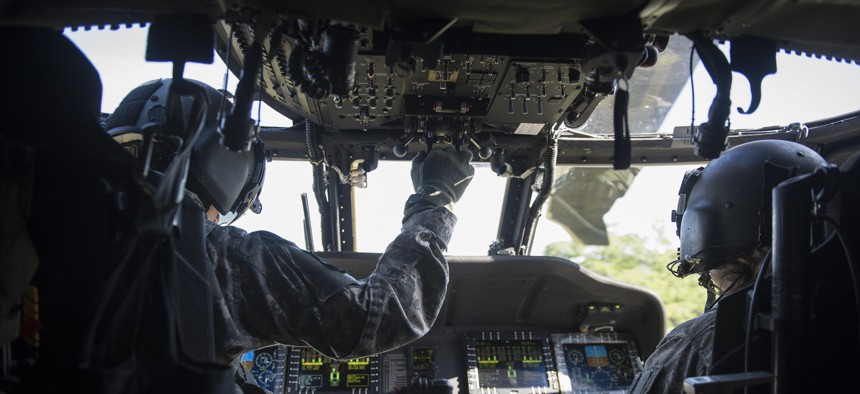 U.S. Army Chief Warrant Officer 4 Keith LeBlanc, left, and Chief Warrant Officer 2, both pilots with Charlie Company, 3rd Battalion, 126th Aviation Regiment (Air Ambulance), Vermont National Guard, prepare to take off in a HH-60M Blackhawk for a flight during Vigilant Guard 2016 at Camp Johnson, Colchester, Vt., July 30, 2016