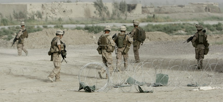 Marines from Bravo Company, Battalion Landing Team 1st Battalion, 6th Marine Regiment, 24th Marine Expeditionary Unit, patrol through a city in Helmand province, Afghanistan, in June 2008.