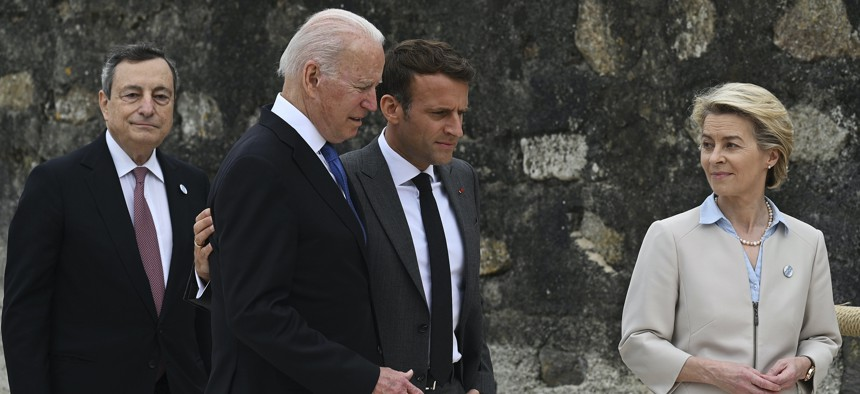 In this June 11, 2021 file photo, from left, Italian Prime Minister Mario Draghi, U.S. President Joe Biden, French President Emmanuel Macron and European Commission President Ursula von der Leyen walk together during the G7 Summit, in Carbis Bay, Cornwall, England.