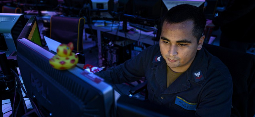 RED SEA (Aug. 25, 2019) Operations Specialist 2nd Class Amulek Moya, assigned to Amphibious Squadron (CPR) 5, stands watch inside the joint operations center aboard amphibious assault ship USS Boxer (LHD 4) during exercise Eager Lion 2019.