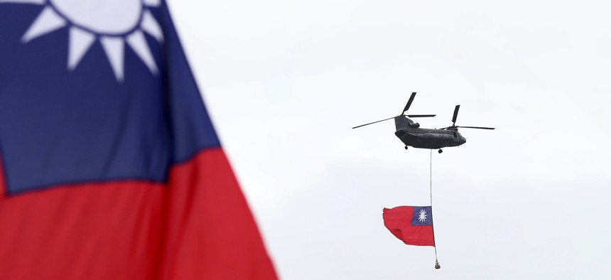 Helicopters fly with the Taiwan national flag during the National Day celebrations in Taipei, Taiwan, Oct. 10, 2020.
