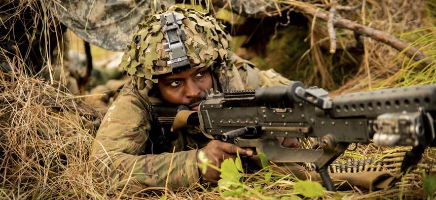 A National Guardsman posts security during training at Fort Polk, La., June 7, 2021.