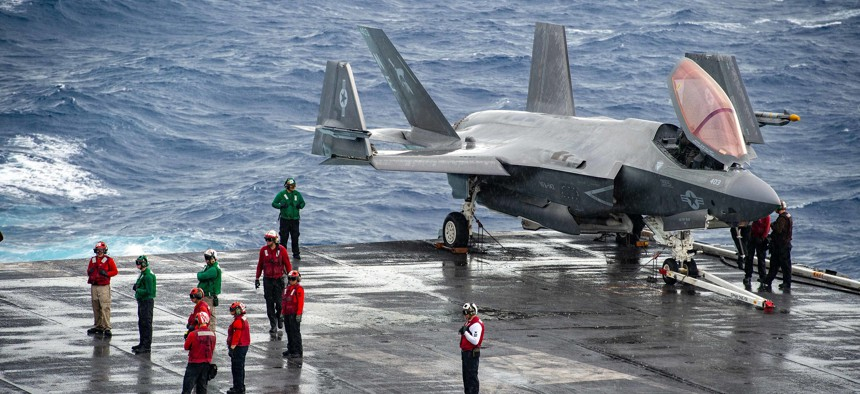 Sailors prepare to position aircraft while conducting flight operations on the flight deck of the Nimitz-class aircraft carrier USS Carl Vinson (CVN 70), Oct. 4, 2021.