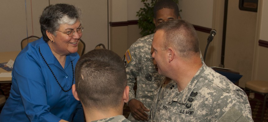 """Brenda """"Sue"""" Fulton, left, greets soldiers in this 2013 photo. Fulton has been nominated to be the assistant defense secretary for manpower and reserve affairs."""