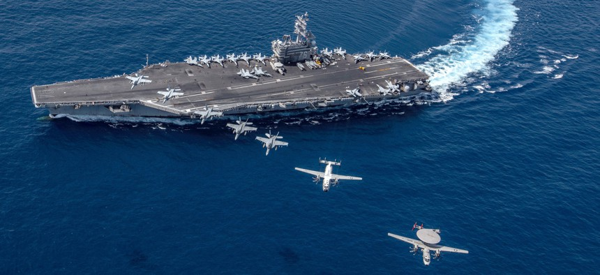 Multiple aircraft from Carrier Air Wing 5 fly in formation over the Navy's forward-deployed aircraft carrier USS Ronald Reagan.
