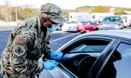 Texas Air National Guard members work a drive-through COVID-19 vaccination site March 15, 2021, at Dietert Center in Kerrville, Texas.