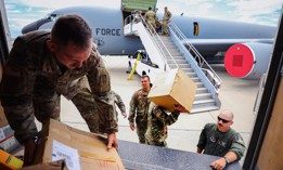 Soldiers assigned to the Indiana National Guard transport donated medical supplies to assist the country of Slovakia in its ongoing fight against COVID-19 at the Indiana National Guard Headquarters in Indianapolis, June 6, 2021.
