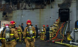 Sailors prepare to board the amphibious assault ship USS Bonhomme Richard (LHD 6) at Naval Base San Diego, July 14, 2020, to support firefighting efforts.