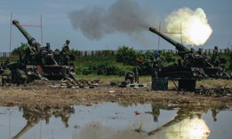 In this photo released by the Taiwan Military News Agency, Taiwanese artillery guns fire live round during the Han Guang exercises held in Taichung, Taiwan, on Thursday, Sept. 16, 2021.
