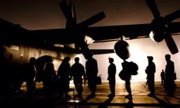 A group of U.S. Army Soldiers line up to board a C-130 Hercules at Bagram Air Field, Afghanistan, Nov. 30, 2008.