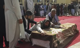 Relatives and residents attend a funeral ceremony for victims of an Islamic State suicide attack at the Gozar-e-Sayed Abad Mosque in Kunduz, northern Afghanistan, Oct. 9, 2021.