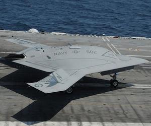 An X-47B lands on the deck of the USS George H.W. Bush after a test flight