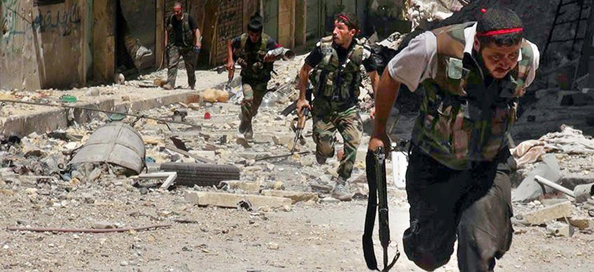 Syrian rebels clash with soldiers loyal to president Bashar Assad in Aleppo