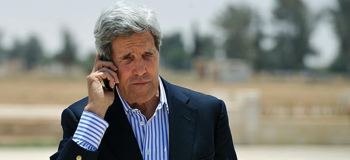 Secretary of State John Kerry speaking on the phone in Jordan