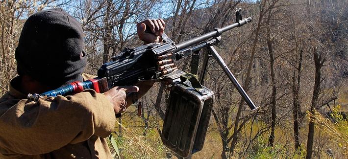 A Pakistani Taliban militant firing a machine gun in Waziristan