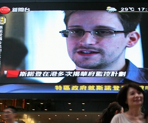 A photograph of NSA leaker Edward Snowden on a screen in Hong Kong