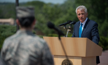 Secretary of Defense Chuck Hagel talks answers a question from an airman at Offutt Air Force Base, Nebraska, on June 20,