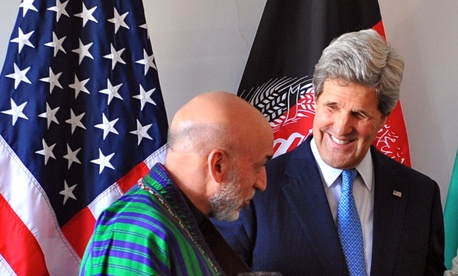 U.S. Secretary of State John Kerry, Afghan President Hamid Karzai and Pakistani Chief of Army Staff Gen. Ashfaq Kayani after a trilateral meeting in Brussels, Belgium, April 24, 2013.