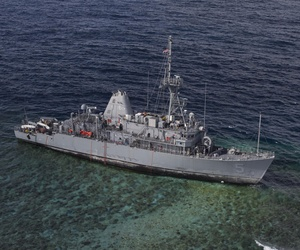 The USS Guardian, sitting aground on a reef near the Phillipines