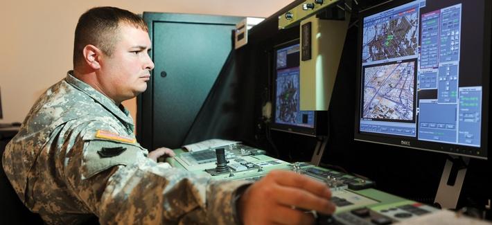 Pennsylvania Army National Guard Sgt. 1st Class Robert Frey pilots an RQ-7B Shadow 200 aircraft on a simulator at Fort Indiantown Gap, Pa.