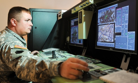 Pennsylvania Army National Guard Sgt. 1st Class Robert Frey pilots an RQ-7B Shadow 200 aircraft on a simulator at Fort Indiantown Gap, Pa.