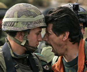 A Palestinian man arguing with an Israeli soldier in Ramallah