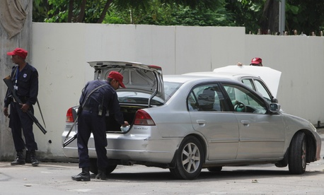 Pakistani guards inspecting a car outside of U.S. Consulate General in Lahore, Pakistan