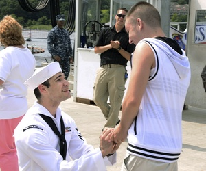 A sailor proposes to his boyfriend after returning from his deployment on the USS New Mexico
